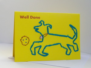 well done dog with ball yellow card