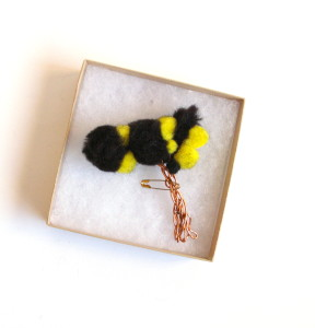 tree badge yellow and black in box